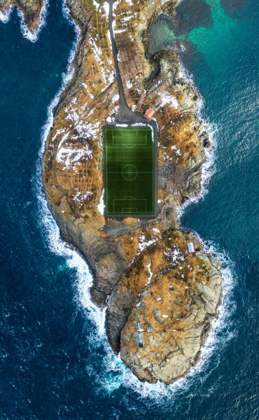 Football field in Henningsvær The famous football field in Henningsvær in Lofoten, Norway lofoten stock pictures, royalty-free photos & images