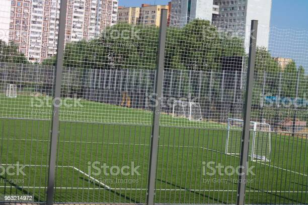 Football field near fence at day sunny day picture id953214972?b=1&k=6&m=953214972&s=612x612&h=f pqyvuzav8iizobkcqf49nr 9o9fdwxi8emlwjjxdo=