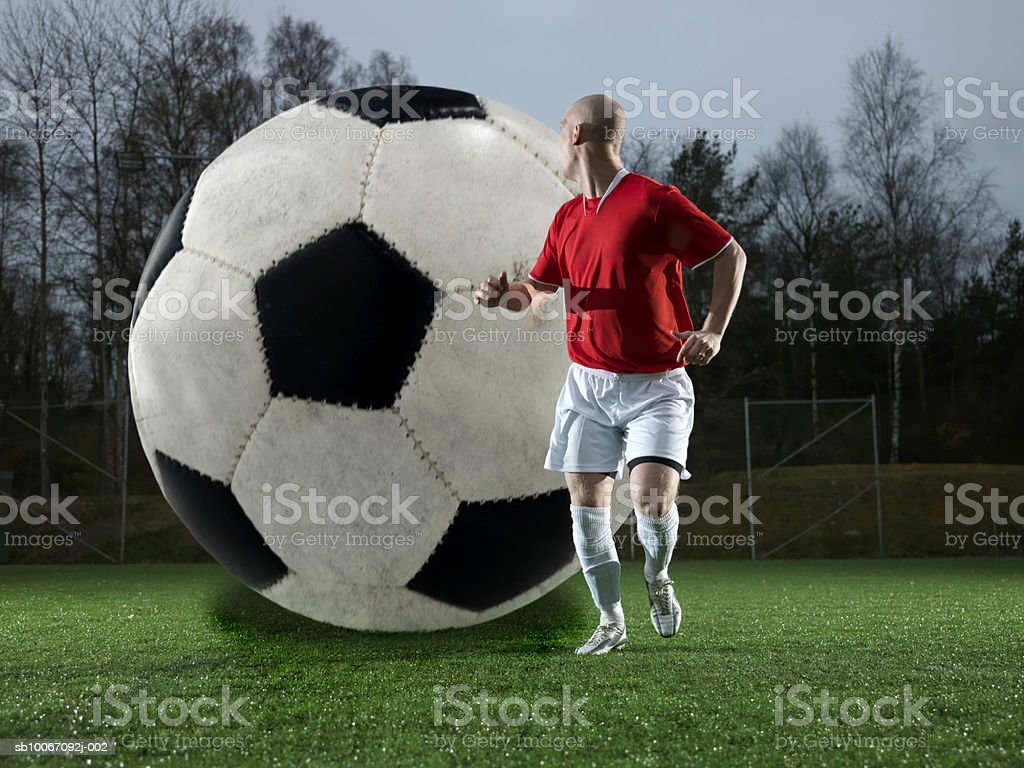 Football following football player royalty-free 스톡 사진