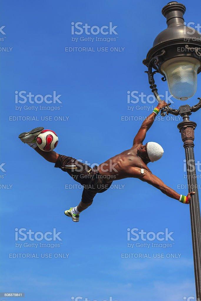 Football Freestyle Iya Traore juggling a Soccer Ball stock photo