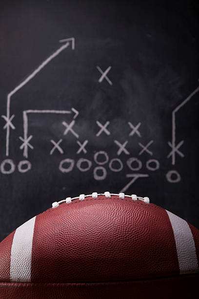 Football Game Plan An American football and a hand drawn chalkboard play. line of scrimmage stock pictures, royalty-free photos & images