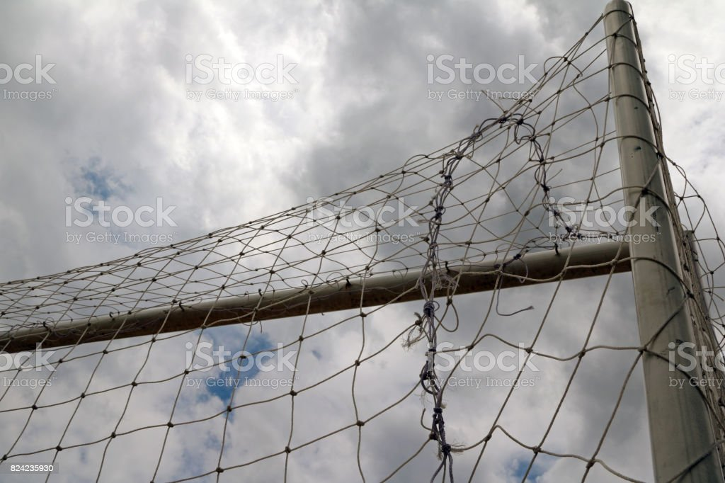 Football goal and net, shooting from the back on many cloud sky background. stock photo