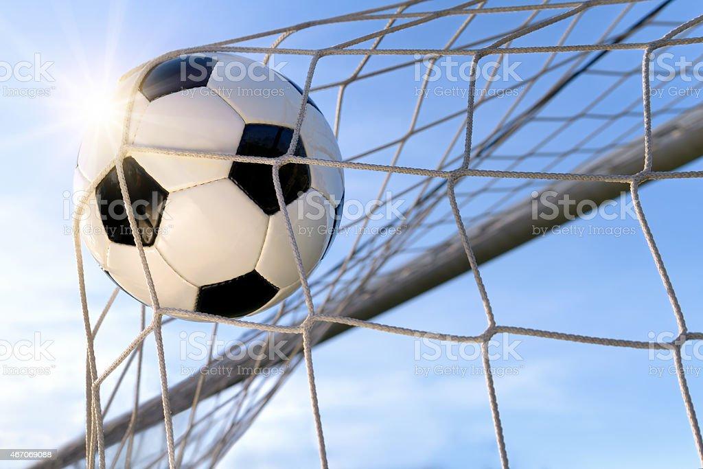 Football Goal, with sun and blue sky stock photo
