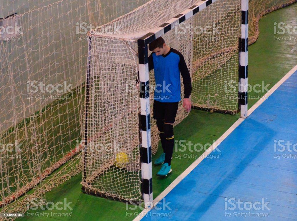 Football Goalkeeper On Goal Field Futsal Ball Field In The Gym ... b41bc91e18ea5