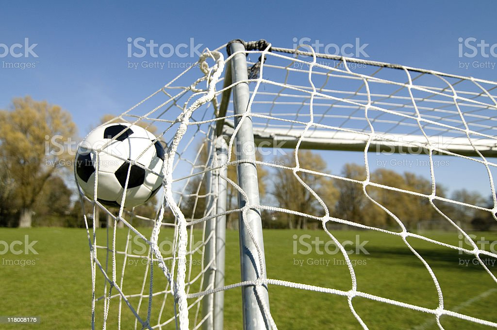 Football goes into the net with full power royalty-free stock photo