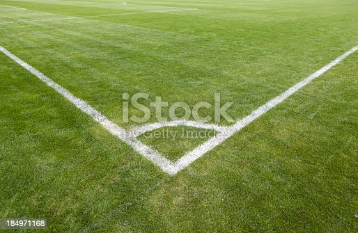 Football green grass field with corner white lines