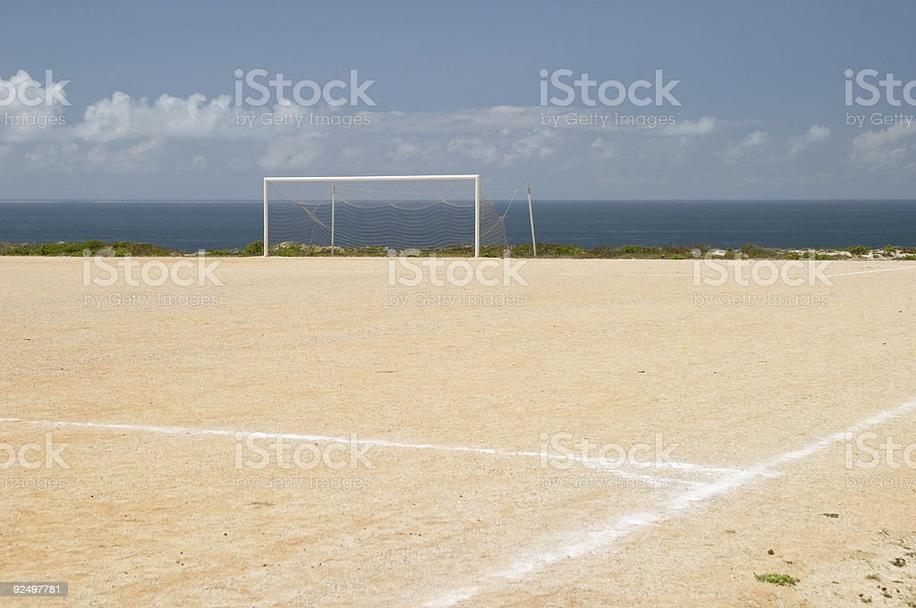 Football ground field in front of the Atlantic ocean royalty-free stock photo