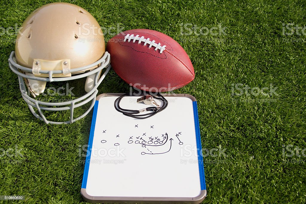 Football Helmet Ball Clipboard and Whistle Landscape stock photo