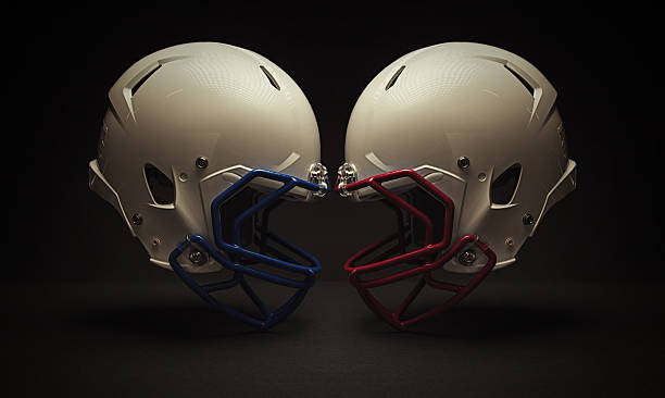 football helmet clash Profile of two helmets face to face. football helmet stock pictures, royalty-free photos & images