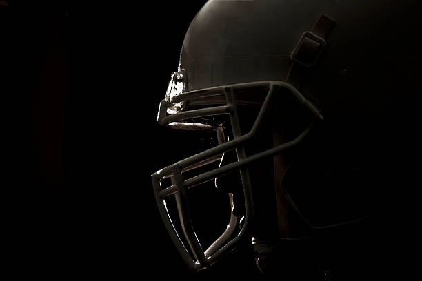 football helmet closeup 01 - american football player stock photos and pictures