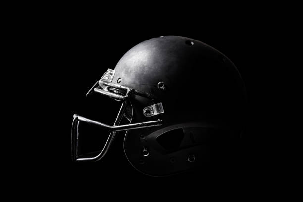 Football helmet on black background. Football helmet on black background. football helmet stock pictures, royalty-free photos & images