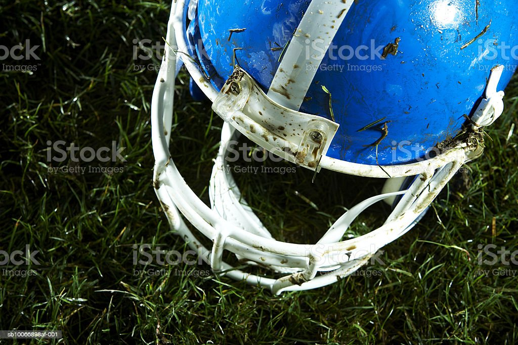 Football helmet on grass 免版稅 stock photo