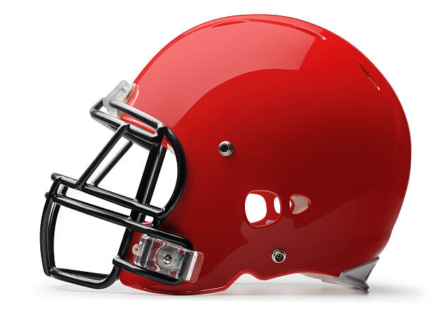 Football Helmet A red football helmet on white background. Clipping path included. football helmet stock pictures, royalty-free photos & images