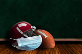 istock Football Helmet Wearing Mask With Chalkboard Background and Copy Space 1216660488