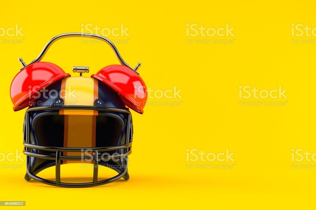 Football helmet with alarm clock royalty-free stock photo
