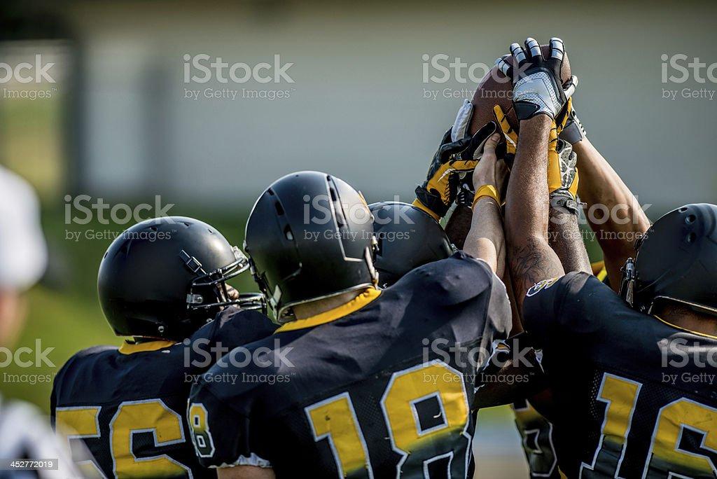 Football huddle and cheer stock photo