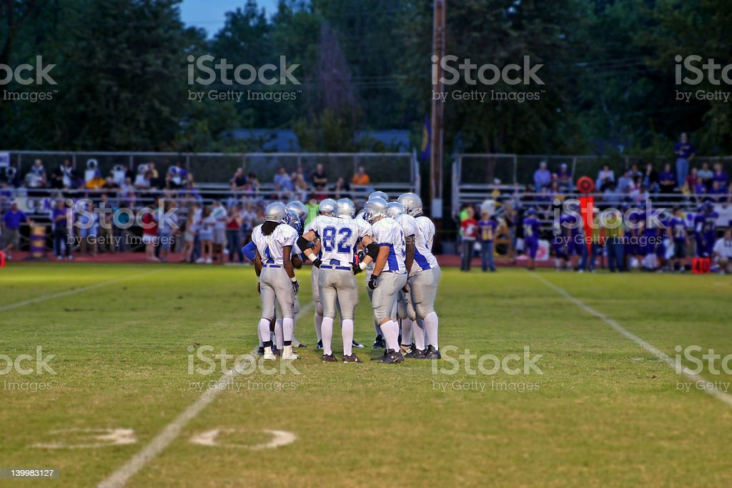 Football huddle stock photo