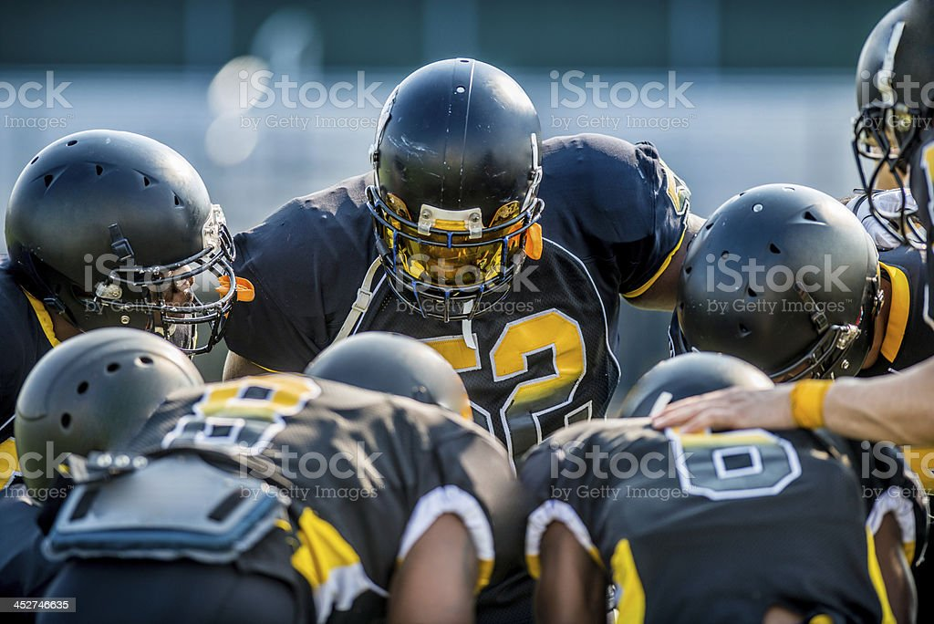 Football huddle stock photo
