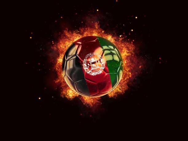 Futebol em chamas com a bandeira do Afeganistão - foto de acervo