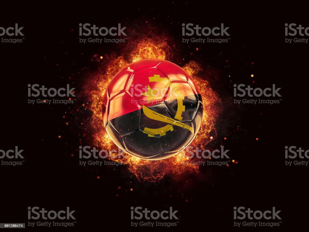 Football in flames with flag of angola stock photo