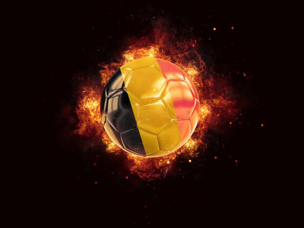 Football in flames with flag of belgium stock photo