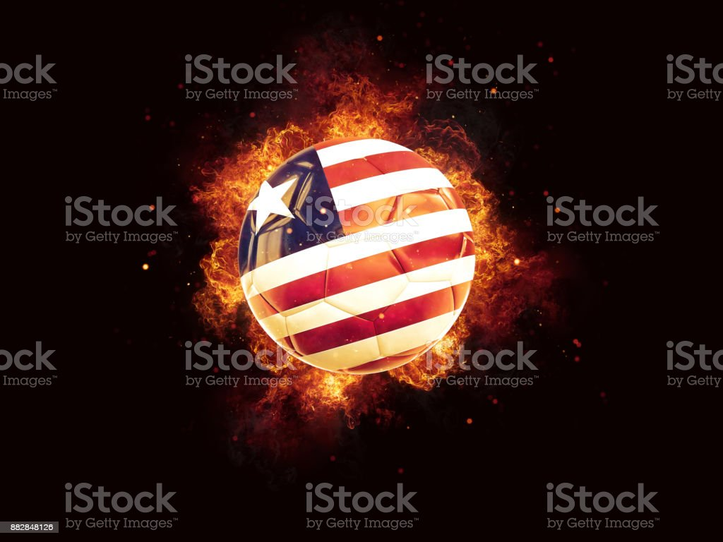 Football in flames with flag of liberia stock photo