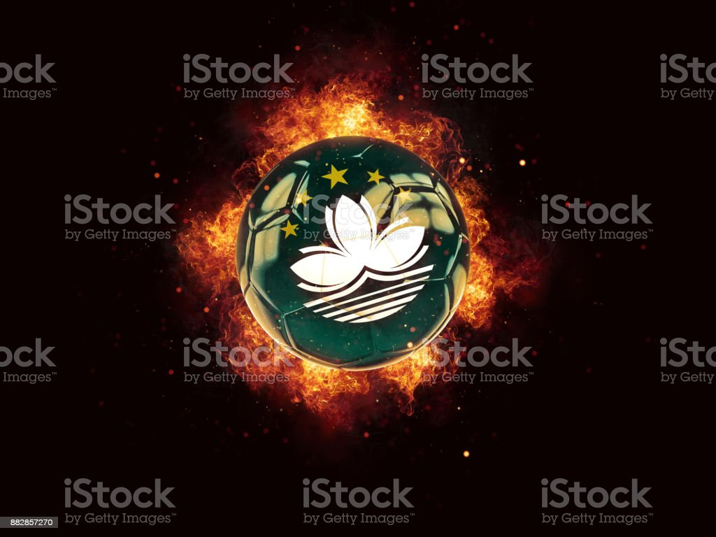 Football in flames with flag of macao stock photo