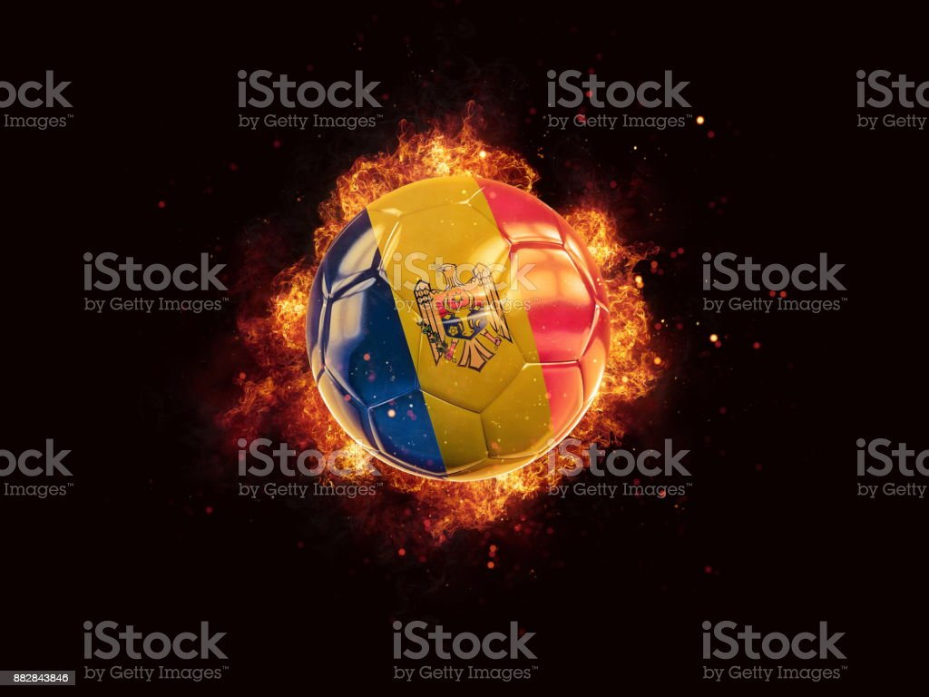 Football in flames with flag of moldova stock photo