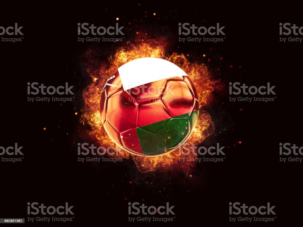 Football in flames with flag of oman stock photo
