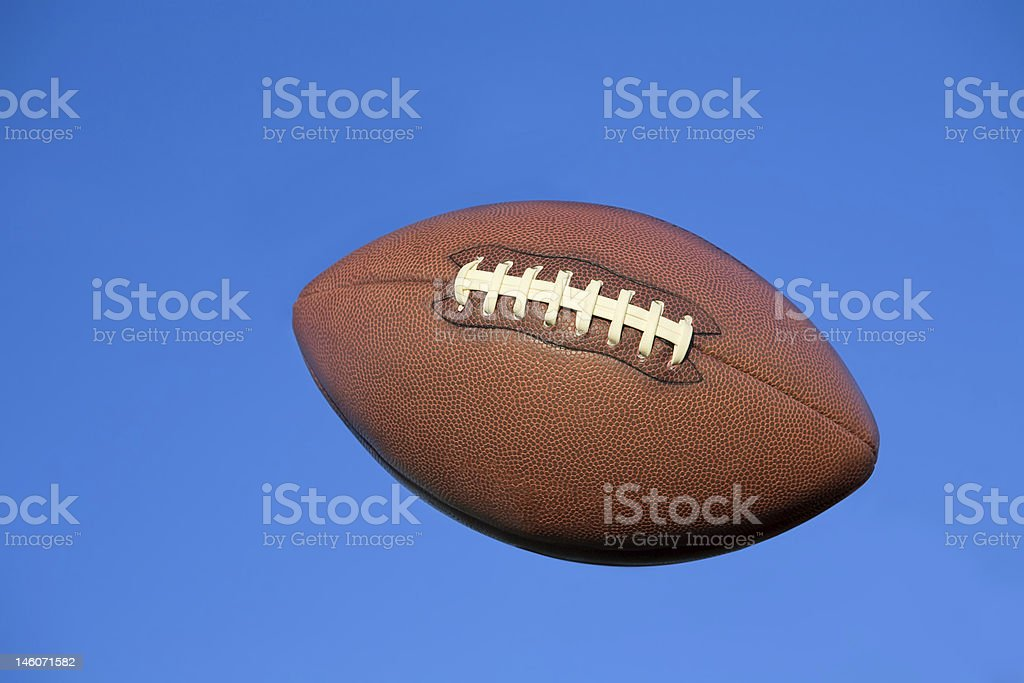 Football in flight with clipping path stock photo