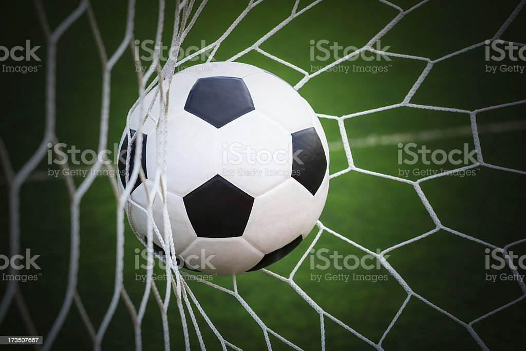 football in goal net royalty-free stock photo