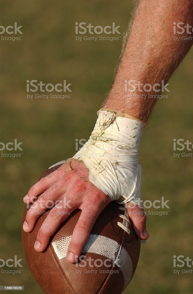 football in hand royalty-free stock photo