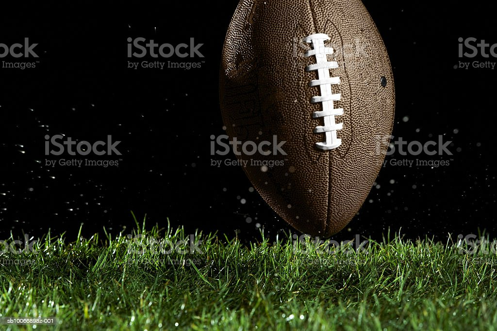 Football in motion over grass royalty-free stock photo