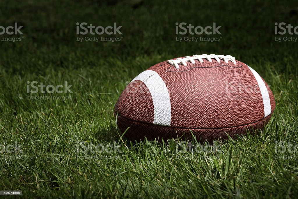 Football in the spotlight stock photo