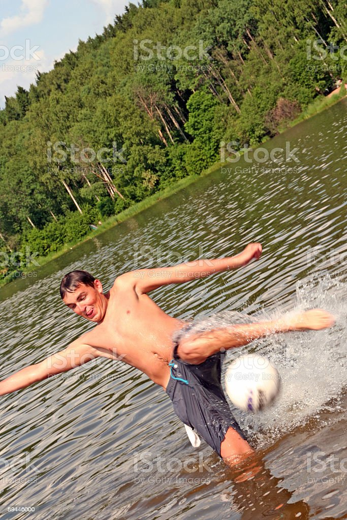 Football in water royalty-free stock photo
