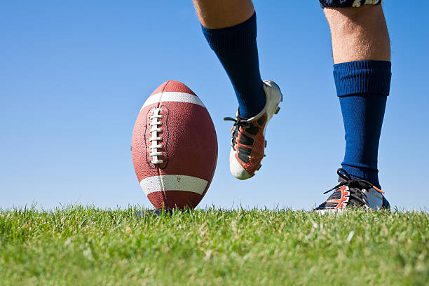 Football Kickoff American Football Kickoff close-up photo. Athlete ready to kick the ball. Horizontal with lots of Copy Space studded stock pictures, royalty-free photos & images
