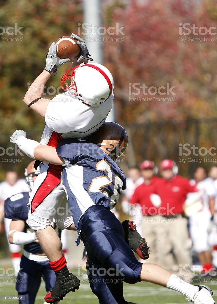 NCAA Football - Leaping Catch stock photo