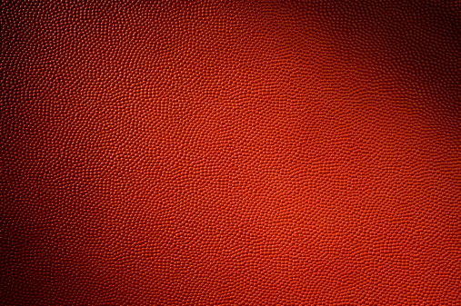 Football - Background. Close-up of the dimpled textured leather hide that makes up a football