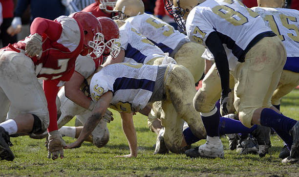 "Football line blocking ""American football line of scimmage, shortly after the ball is snapped."" line of scrimmage stock pictures, royalty-free photos & images"