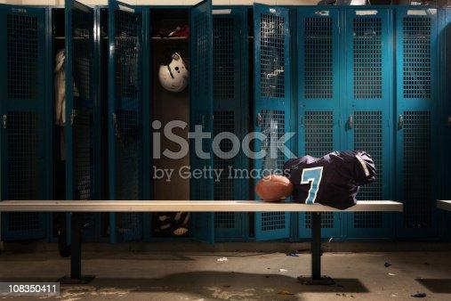 Messy football locker room.