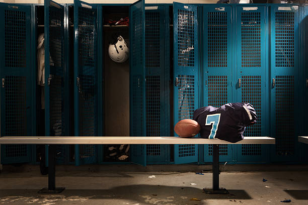 Football Locker room Messy football locker room. american football uniform stock pictures, royalty-free photos & images