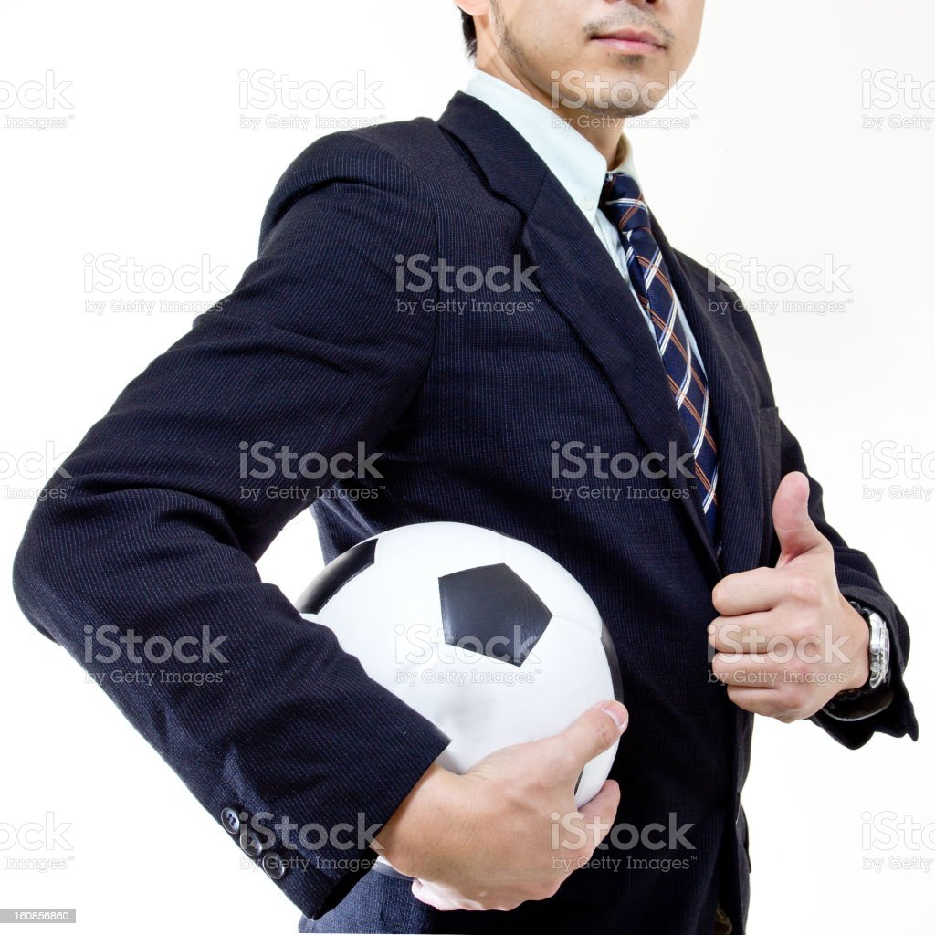 Football manager hold ball with his hands royalty-free stock photo