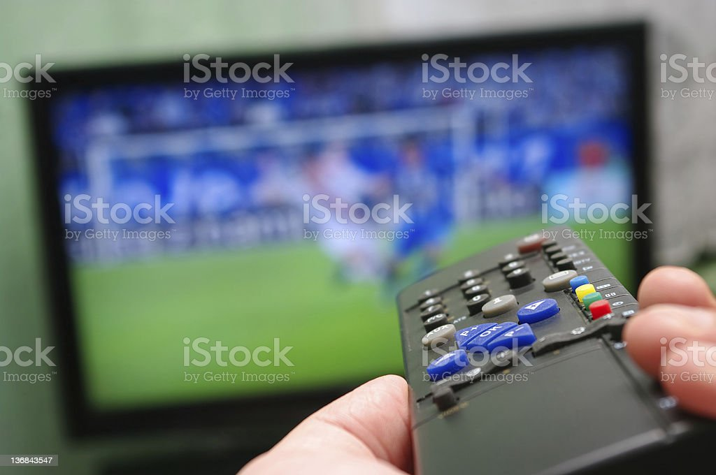 Football match and remote control - Royalty-free Adult Stock Photo