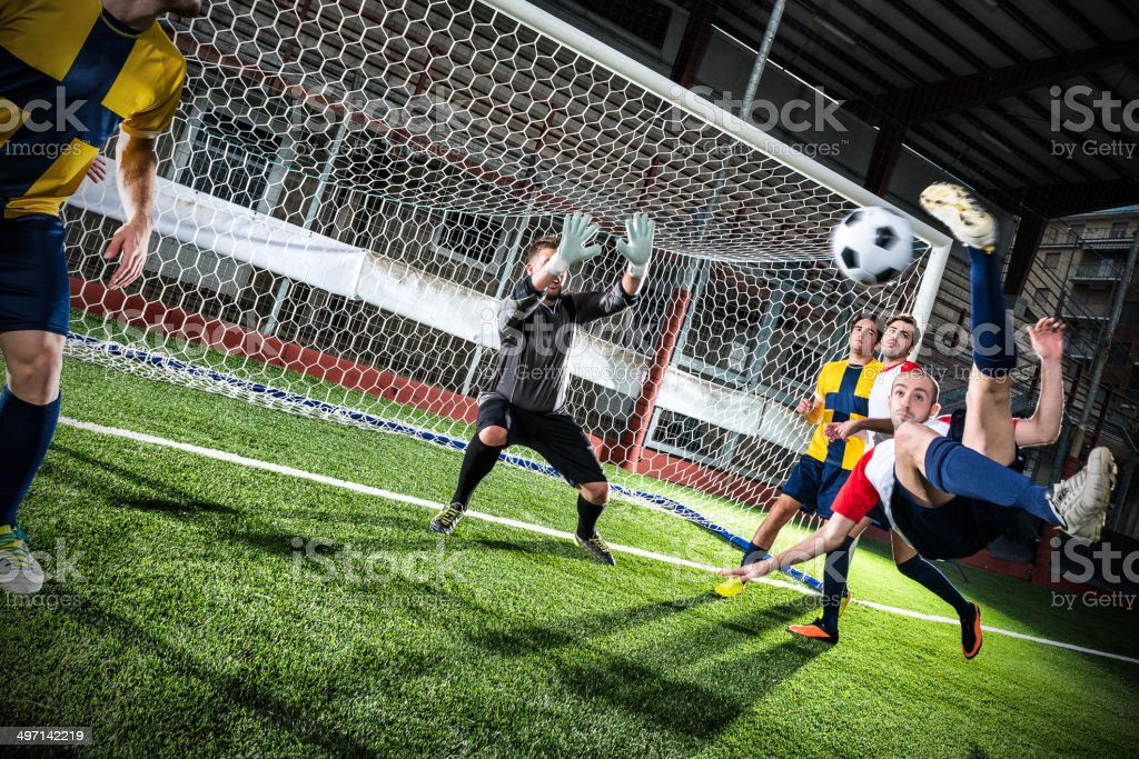 Football match in stadium: Bicycle kick stock photo