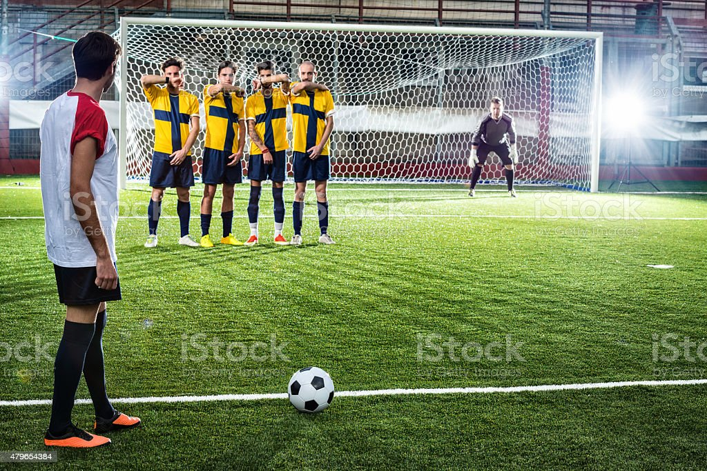 Football match in stadium: Free kick stock photo
