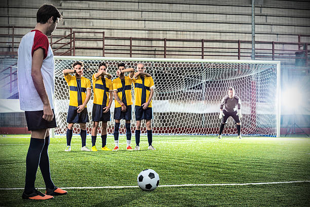 football match in stadium: free kick - sports championship stock photos and pictures