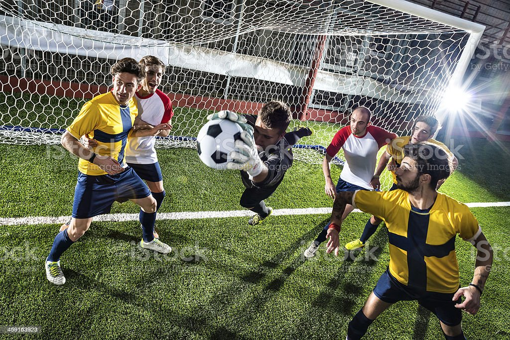 Football match in stadium: Goalkeeper save stock photo