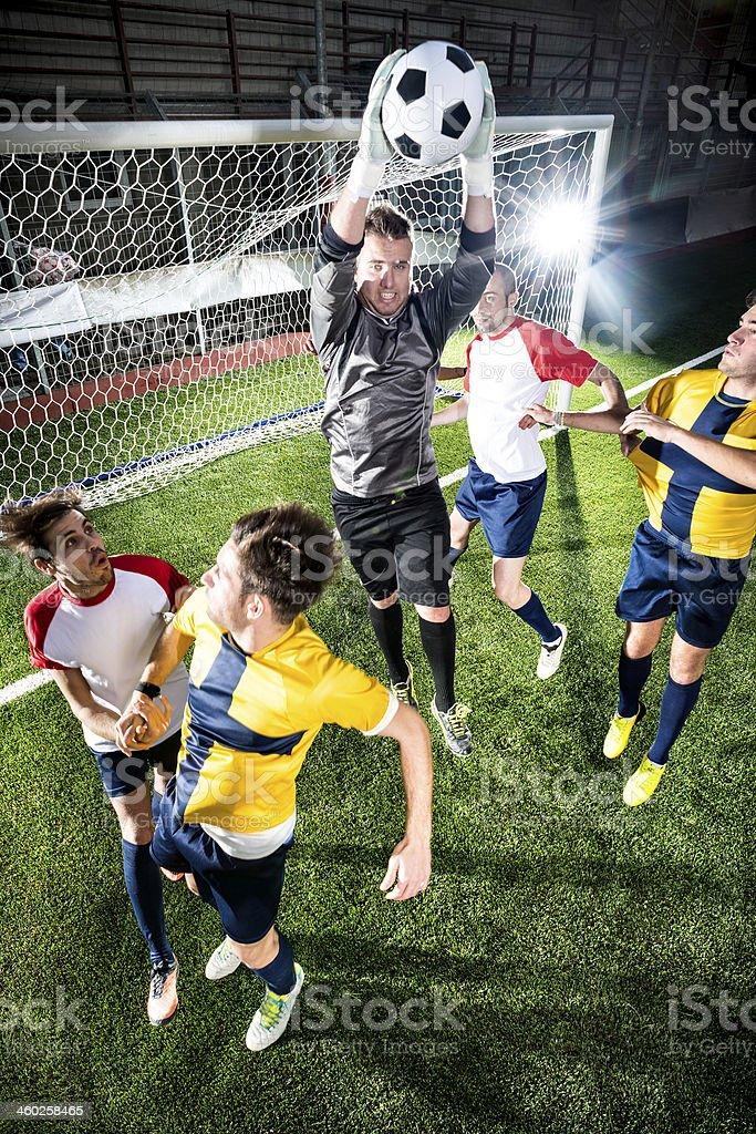 Football match in stadium: Goalkeeper save royalty-free stock photo