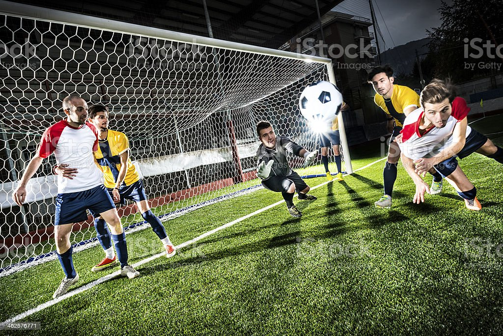 Football match in stadium: Header goal stock photo