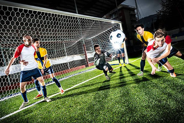 football match in stadium: header goal - soccer competition stock photos and pictures
